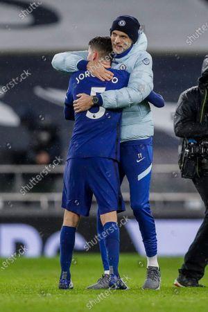 Chelsea's head coach Frank Lampard embraces Chelsea's Jorginho after the English Premier League soccer match between Tottenham and Chelsea at the Tottenham Hotspur Stadium in London, England