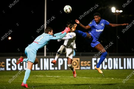 Belenenses SAD´s goalkeeper Kritciuk (L) and Bruno Ramires (R) fight for the ball with FC Porto's player Nanu during the Portuguese First League soccer match Belenenses SAD and FC Porto held at Jamor Stadium, Lisbon, Portugal, 04 February 2021.
