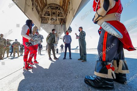 Stock Photo of Former NFL players Martin Gramatica (C) and Cris Carter (L) learn about the US Air Force's B-1 bomber from Major Ryan Combes (R) during a Salute to Service community outreach event to honor US military members at MacDill Air Force Base ahead of the NFL Super Bowl LV in Tampa, Florida, USA, 04 February 2021. The AFC Champion Kansas City Chiefs and the NFC Champion Tampa Bay Buccaneers will face off in NFL Super Bowl LV at Raymond James Stadium on 07 February 2021. A scheduled flyover during the US national anthem will include the B-1, B-2 and B-52.