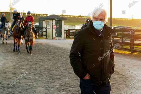 Stock Image of Horse trainer Bob Baffert walks through the stable area during morning workouts for the Breeders' Cup horse races at Keeneland Race Course in Lexington, Ky. Gamine has been disqualified from a third-place finish in last year's Kentucky Oaks and Hall of Fame trainer Bob Baffert fined $1,500 after a post-race test showed the filly had an anti-inflammatory in her system. Kentucky stewards issued their ruling Jan. 30 and it was posted on the Kentucky Horse Racing Commission's website this week