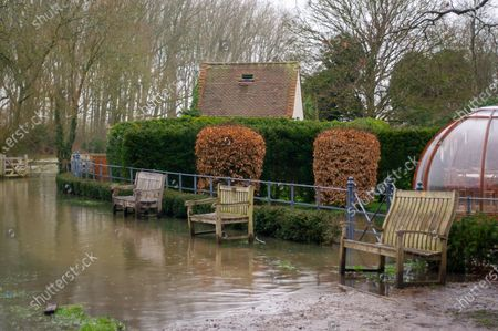 Stock Photo of The Thames Path near Sonning Bridge is impassable due to flooding. Following heavy rain over the past few days, the River Thames has burst it's banks at Sonning in Berkshire. A Flood Alert is in place and low lying roads, paths and fields have flooded
