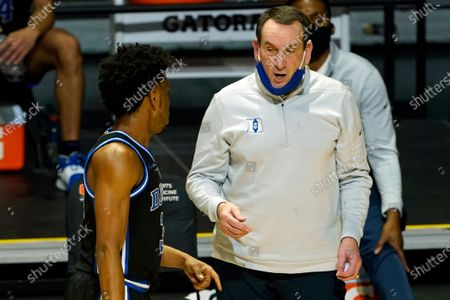 Duke head coach Mike Krzyzewski talks to guard Jeremy Roach (3) during the second half of an NCAA college basketball game against Miami in Coral Gables, Fla. Krzyzewski's Blue Devils host rival North Carolina, with it marking the first meeting with both teams unranked since 1960