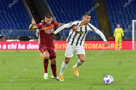 Cristiano Rolando of Juventus and Davide Santon of AS Roma seen in action during the  Italian Football Championship League A 2020/2021 match between AS Roma vs FC Juventus at the Olimpic Stadium in Rome. (Final score; AS Roma 2-2 FC Juventus)