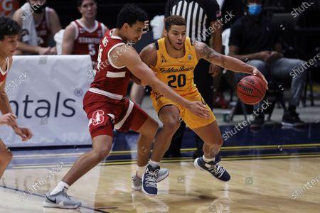 Stanford forward Spencer Jones defends against California forward Matt Bradley during the first half of an NCAA college basketball game in Berkeley, Calif