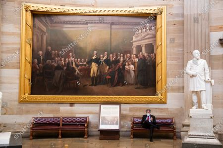 The incoming Chair of the Senate Banking, Housing and Urban Affairs Committee, Democrat of Ohio Sherrod Brown, sits beneath the oil painting by American artist John Trumbull, 'General George Washington Resigning His Commission', in the Capitol Rotunda in Washington, DC, USA, 04 February 2021.