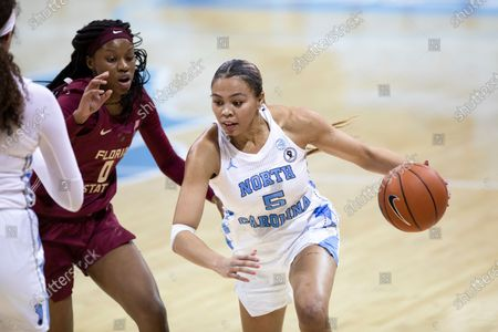 Stock Picture of North Carolina's Stephanie Watts (5) drives past Florida State's Bianca Jackson (0) during an NCAA college basketball game in Chapel Hill, N.C