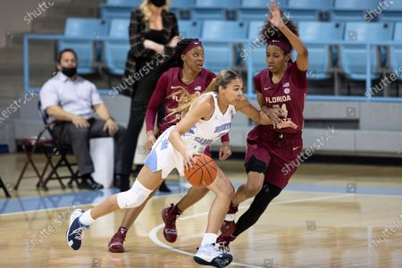 North Carolina's Stephanie Watts (5) handles the ball as Florida State's Morgan Jones (24) defends during an NCAA college basketball game in Chapel Hill, N.C