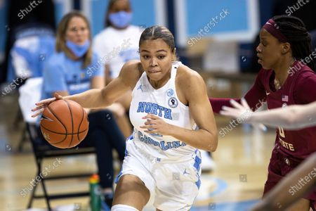 Stock Image of North Carolina's Stephanie Watts (5) drives past Florida State's Bianca Jackson (0) during an NCAA college basketball game in Chapel Hill, N.C