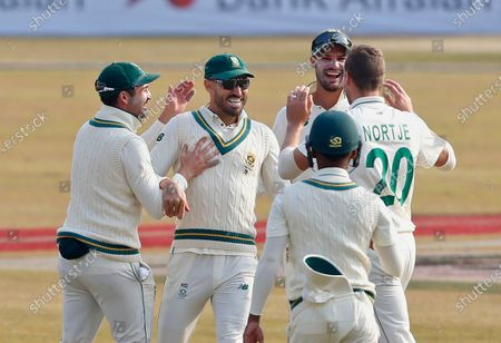 South Africa's Faf du Plessis, second left, celebrates with teammates after the dismissal of Pakistan's Babar Azam during the first day of the second cricket test match between Pakistan and South Africa at the Pindi Stadium in Rawalpindi, Pakistan