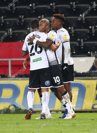 Andre Ayew of Swansea City celebrates with team mate Kyle Naughton after scoring his sides first goal making it 1-0 in the 42nd minute; Liberty Stadium, Swansea, Glamorgan, Wales; English Football League Championship Football, Swansea City versus Norwich City.