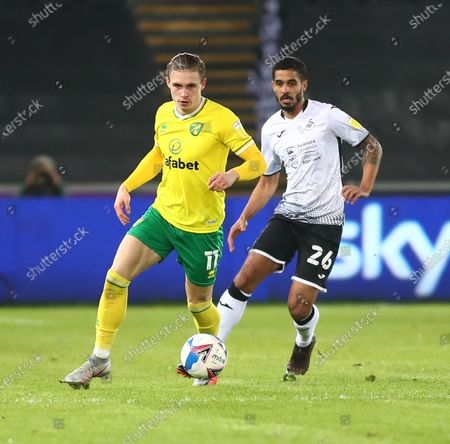 Przemyslaw Placheta of Norwich City controls the ball as Kyle Naughton of Swansea City pressures from behind; Liberty Stadium, Swansea, Glamorgan, Wales; English Football League Championship Football, Swansea City versus Norwich City.