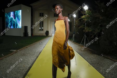 Stock Image of Model on the catwalk at the Salvatore Ferragamo Fashion show in Milan, Spring Summer 2021, Ready to Wear Fashion WeekCollection designed by Paul Andrew and Guillaume Meilland