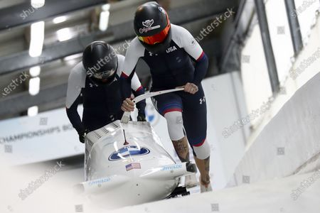 Kaillie Humphries and Lolo Jones of the United States start during the two women's bobsleigh race at the Bobsleigh and Skeleton World Championships in Altenberg, Germany