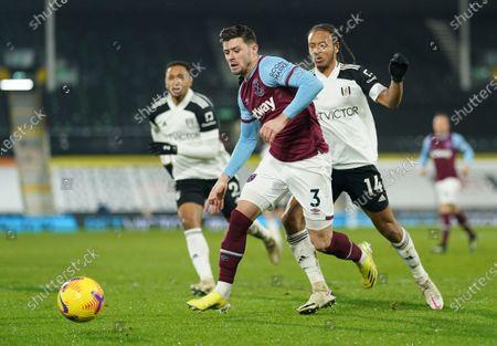 Aaron Cresswell of West Ham United wins the ball off Bobby De Cordova Reid of Fulham