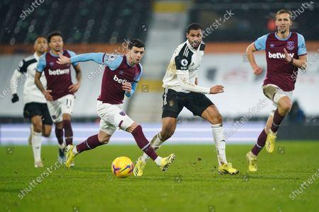 Ruben Loftus-Cheek of Fulham plays the ball past Aaron Cresswell of West Ham United