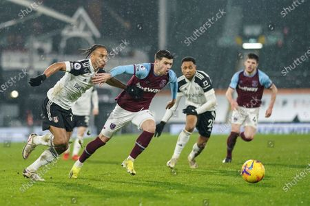 Bobby De Cordova Reid of Fulham and Aaron Cresswell of West Ham United chase the ball