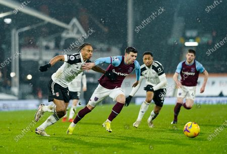 Bobby De Cordova Reid of Fulham and Aaron Cresswell of West Ham