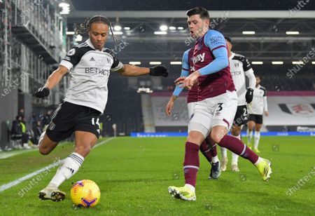 Bobby De Cordova Reid of Fulham crosses the ball while under pressure from Aaron Cresswell of West Ham United