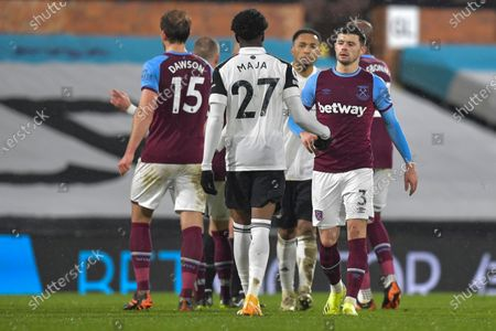 Aaron Cresswell of West Ham United shakes hands with Fulham new signing Josh Maja