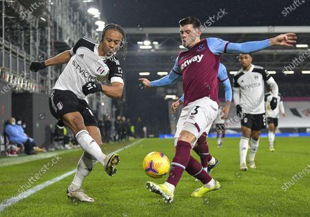 Bobby Decordova-Reid of Fulham crosses under pressure from Aaron Cresswell of West Ham United