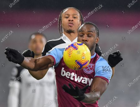 Michail Antonio of West Ham United chests the ball under pressure from Bobby De Cordova Reid of Fulham