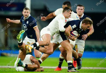 Henry Slade of England tries to stop Chris Harris of Scotland
