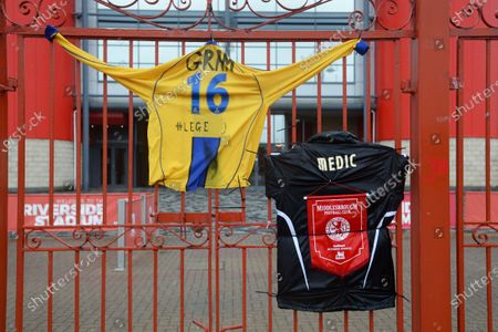 Stock Picture of Shirts hung on the gate in tribute to retired paramedic Graham Hunter who came out of retirement to help fight the pandemic, passed away from Coronavirus this week. Graham a keen Middlesbrough supporter would volunteer his medical services at games when able.
