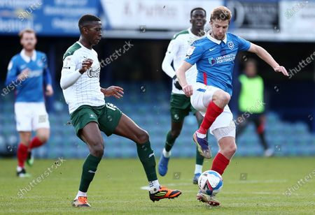 Michael Jacobs of Portsmouth and Tyrese Fornah of Plymouth Argyle.
