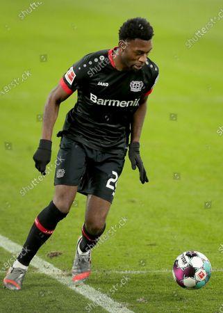 Leverkusen's Timothy Fosu-Mensah plays the ball during the German Bundesliga soccer match between RB Leipzig and Bayer 04 Leverkusen in Leipzig, Germany