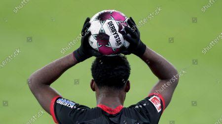 Leverkusen's Timothy Fosu-Mensah throws in the ball during the German Bundesliga soccer match between RB Leipzig and Bayer 04 Leverkusen in Leipzig, Germany