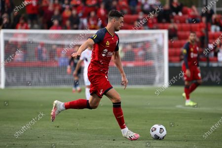Stock Photo of Tomi Juric of Adelaide United kicks the ball during the Hyundai A-League soccer match between Adelaide United and Perth Glory FC .