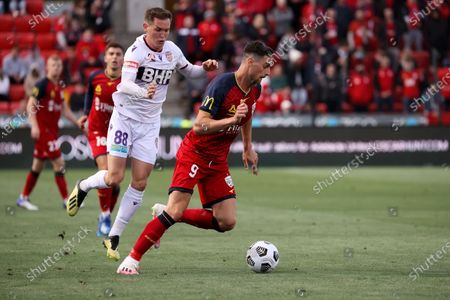 Tomi Juric of Adelaide United kicks the ball during the Hyundai A-League soccer match between Adelaide United and Perth Glory FC .