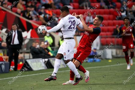Stock Picture of Darryl Lachman of Perth Glory and Tomi Juric of Adelaide United clash during the Hyundai A-League soccer match between Adelaide United and Perth Glory FC .