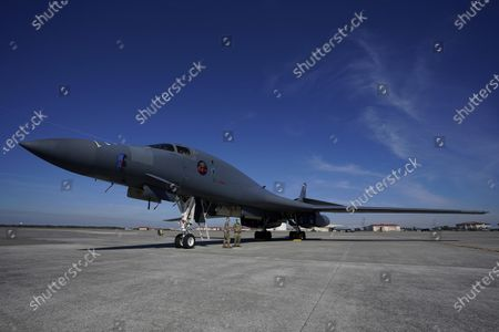 United Air Force B1-B Bomber sits on the tarmac as NFL greats Chris Carter and Martin Gramitica tour the base in a Salute to Service event at MacDill AFB, in Tampa, Fla