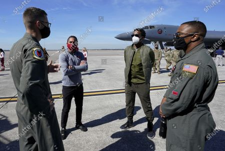 Former NFL players Chris Carter, right center, and Martin Gramitica, left center, are given a tour of a United Air Force B1-B Bomber in a Salute to Service event at MacDill AFB, in Tampa, Fla