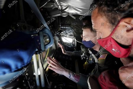Former NFL players Chris Carter and Martin Gramitica, foreground are given a tour of the refueling pod of a United Air Force KC-135 in a Salute to Service event at MacDill AFB, in Tampa, Fla