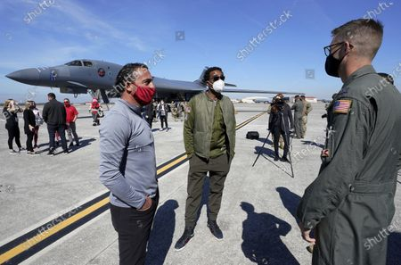 Former NFL players Chris Carter, center, and Martin Gramitica, left, are given a tour of a United Air Force B1-B Bomber in a Salute to Service event at MacDill AFB, in Tampa, Fla