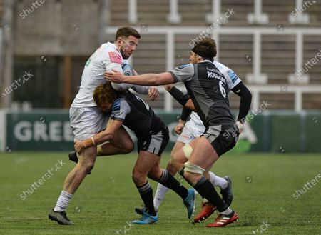 Alex Cuthbert of Exeter Chiefs is tackled by Sam Stuart of Newcastle Falcons