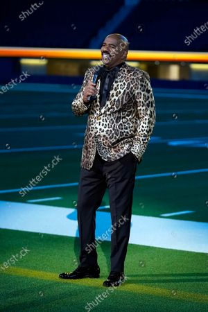 Stock Photo of Steve Harvey stands on the field at SoFi Stadium during the NFL Honors football awards show, in Los Angeles