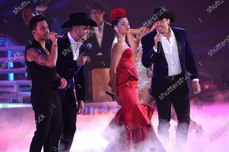 """Prince Royce, left, Natalia Jimenez, second from right, and members of Calibre 50 perform at the 20th Latin Grammy Awards at the MGM Grand Garden Arena in Las Vegas. The band released a new album, """"Vamos Bien,"""" on"""