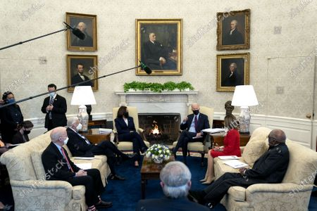 U.S. President Joe Biden, center right, and Vice President Kamala Harris, meet with, from right, House Majority Whip Jim Clyburn, Speaker of the House Nancy Pelosi, House Majority Leader Steny Hoyer, and Representative Peter Defazio in the Oval Office of the White House in Washington