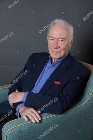 """Stock Picture of Christopher Plummer poses for a portrait to promote his film """"Boundaries"""", in New York. Plummer, the dashing award-winning actor who played Captain von Trapp in the film """"The Sound of Music"""" and at 82 became the oldest Academy Award winner in history, has died. He was 91. Plummer died Friday morning, Feb. 5, 2021, at his home in Connecticut with his wife, Elaine Taylor, by his side, said Lou Pitt, his longtime friend and manager"""