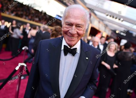 """Christopher Plummer arrives at the Oscars, in Los Angeles. Plummer, the dashing award-winning actor who played Captain von Trapp in the film """"The Sound of Music"""" and at 82 became the oldest Academy Award winner in history, has died. He was 91. Plummer, the dashing award-winning actor who played Captain von Trapp in the film """"The Sound of Music"""" and at 82 became the oldest Academy Award winner in history, has died. He was 91. Plummer died Friday morning, Feb. 5, 2021, at his home in Connecticut with his wife, Elaine Taylor, by his side, said Lou Pitt, his longtime friend and manager"""