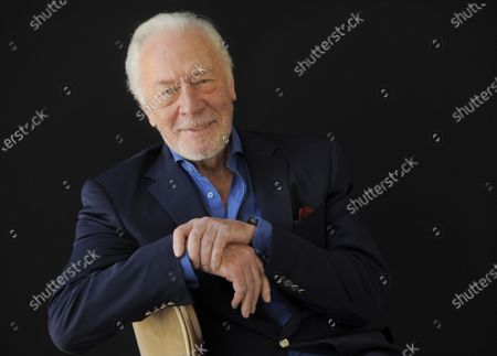 """Christopher Plummer poses for a portrait, in Beverly Hills, Calif. Plummer, the dashing award-winning actor who played Captain von Trapp in the film """"The Sound of Music"""" and at 82 became the oldest Academy Award winner in history, has died. He was 91. Plummer died Friday morning, Feb. 5, 2021, at his home in Connecticut with his wife, Elaine Taylor, by his side, said Lou Pitt, his longtime friend and manager"""