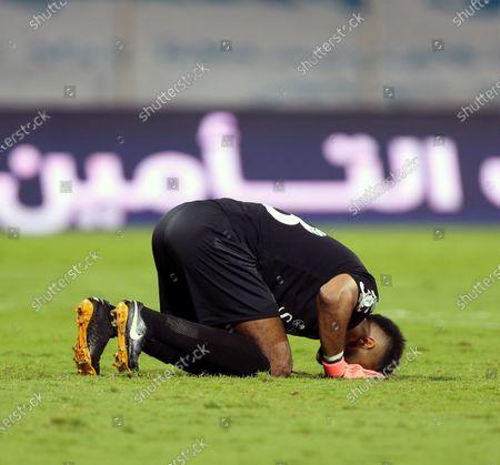 Stock Photo of Al-Ahli's goalkeeper Mohammed Al-Owais kneels after winning the Saudi Professional League soccer match between Al-Wehda and Al-Ahli at King Abdulaziz Stadium, in Mecca, Saudi Arabia, 05 February 2021.