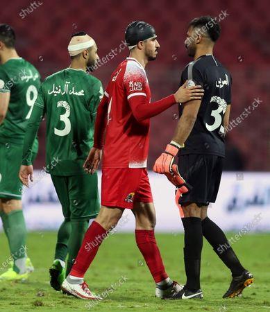 Stock Image of Al-Ahli's goalkeeper Mohammed Al-Owais (R) greets Al-Wehda's Abdullah Al Hafith (2-R) after winning the Saudi Professional League soccer match between Al-Wehda and Al-Ahli at King Abdulaziz Stadium, in Mecca, Saudi Arabia, 05 February 2021.