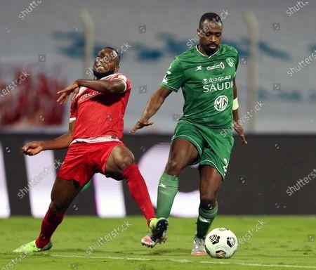 Al-Wehda's player Youssouf Niakate (L) in action against Al-Ahli's Motaz Hawsawi (R) during the Saudi Professional League soccer match between Al-Wehda and Al-Ahli at King Abdulaziz Stadium, in Mecca, Saudi Arabia, 05 February 2021.