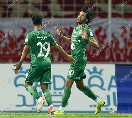 Al-Ahli's player Salman Al-Muwashar (R) celebrates after scoring a goal during the Saudi Professional League soccer match between Al-Wehda and Al-Ahli at King Abdulaziz Stadium, in Mecca, Saudi Arabia, 05 February 2021.