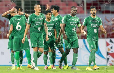 Al-Ahli's player Salman Al-Muwashar (L) celebrates after scoring a goal during the Saudi Professional League soccer match between Al-Wehda and Al-Ahli at King Abdulaziz Stadium, in Mecca, Saudi Arabia, 05 February 2021.
