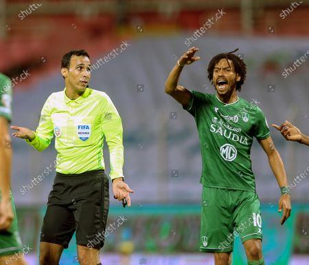 Al-Ahli's player Salman Al-Muwashar (R) reacts during the Saudi Professional League soccer match between Al-Wehda and Al-Ahli at King Abdulaziz Stadium, in Mecca, Saudi Arabia, 05 February 2021.